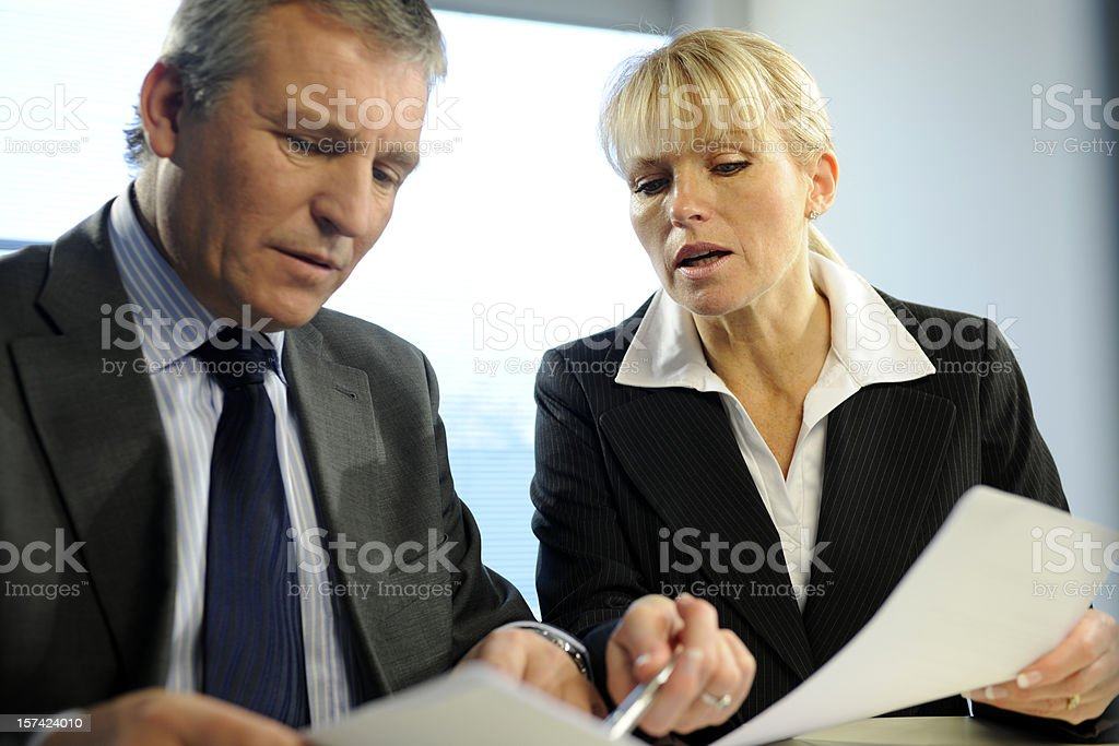 Colleagues in Discussion In Business Meeting royalty-free stock photo