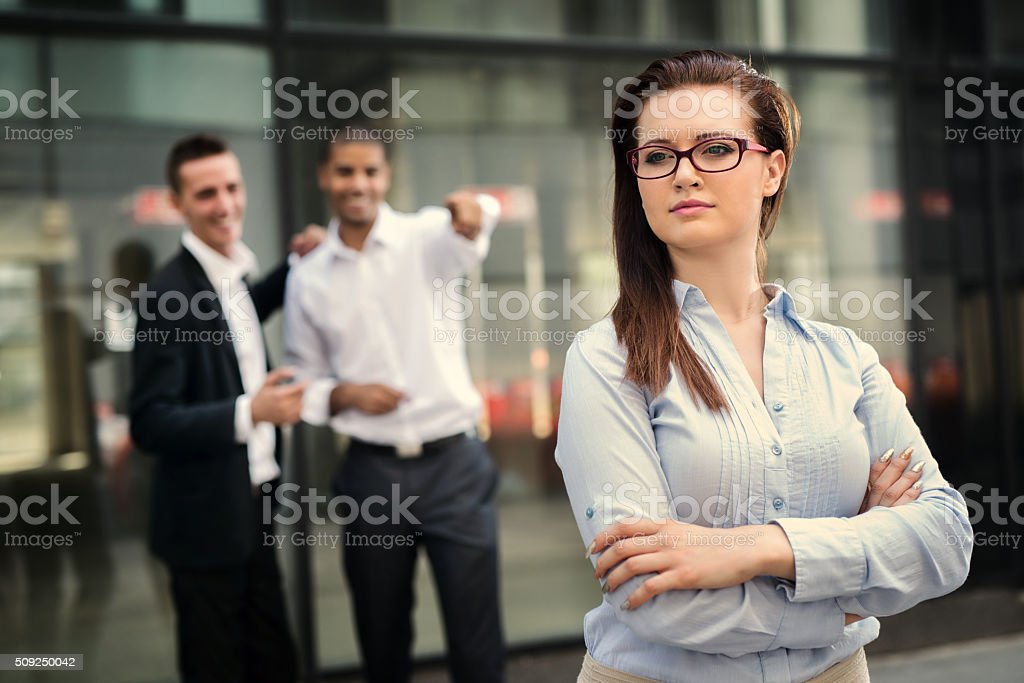 Colleagues in front of their office, stock photo
