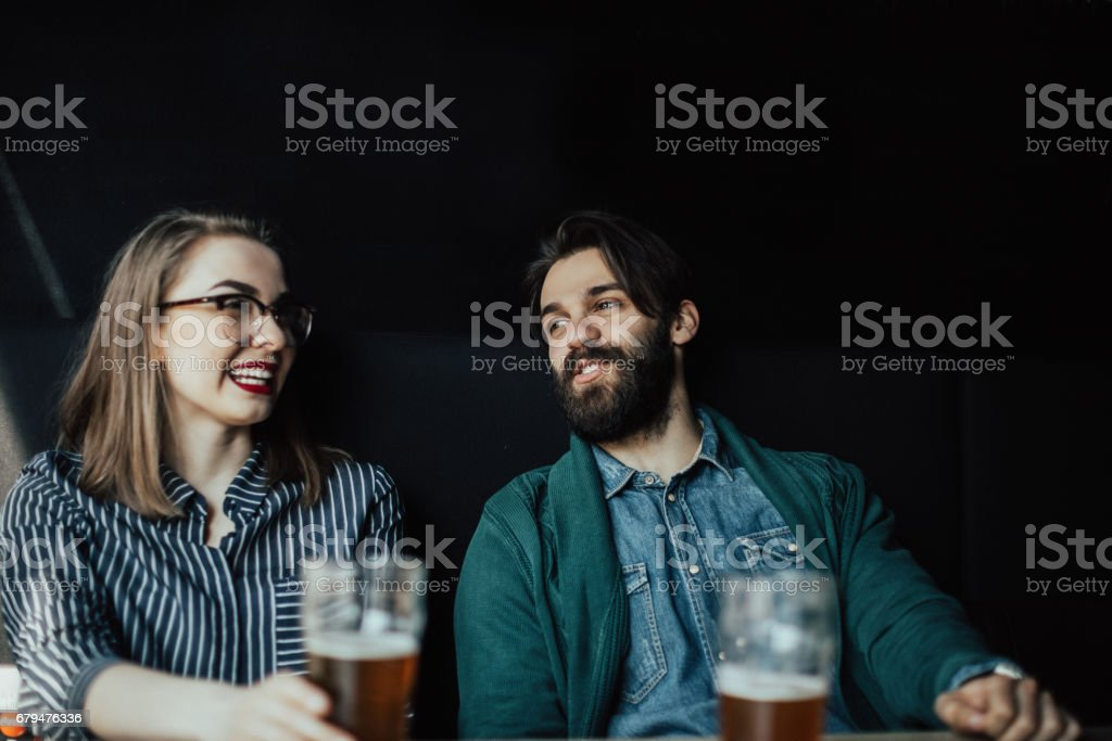 Colleagues in the pub drinking beer after work royalty-free stock photo