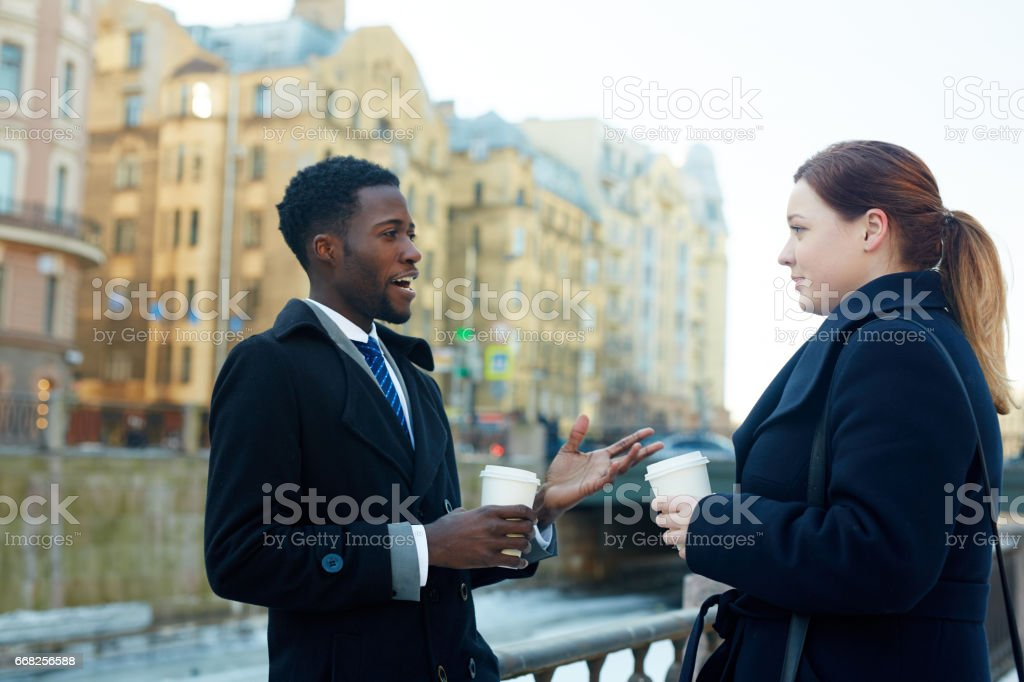 Colleagues Interacting in Streets of City foto stock royalty-free