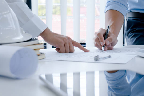 Colleagues interior designer Corporate Achievement Planning Design on blueprint Teamwork Concept with compasse. stock photo