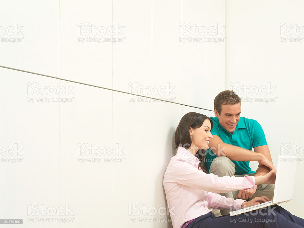 Colleagues looking at a laptop 免版稅 stock photo