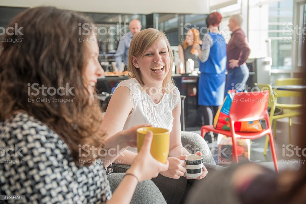 Colleagues relaxing over coffee royalty-free stock photo