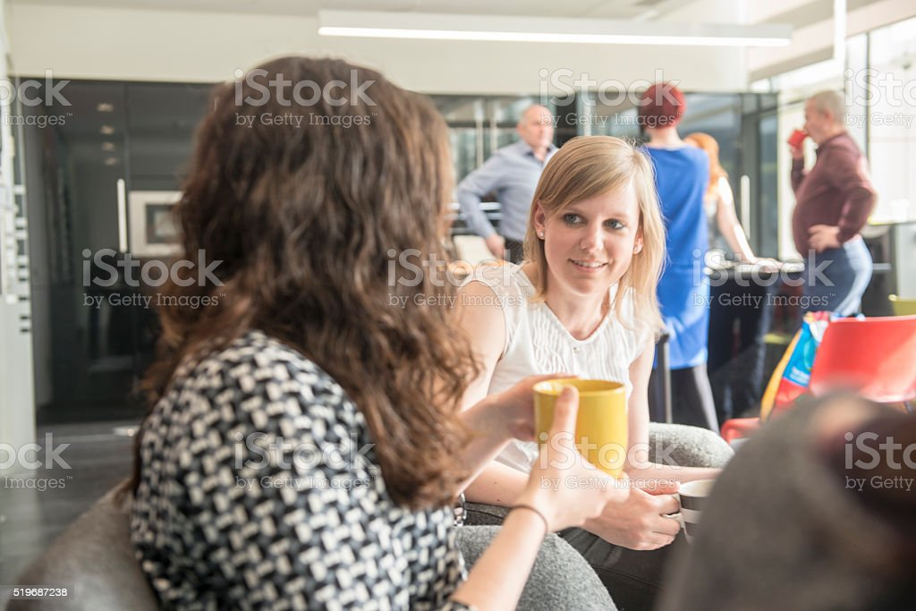 Colleagues relaxing over coffee stock photo