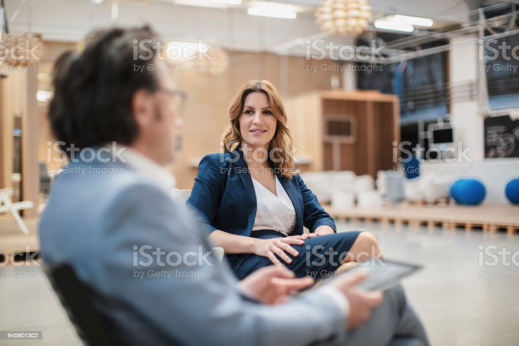creative office space large. Colleagues Sitting In Large Creative Office Space Royalty-free Stock Photo Y