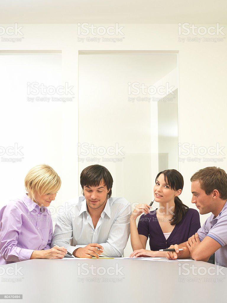 Colleagues talking in a conference room Lizenzfreies stock-foto