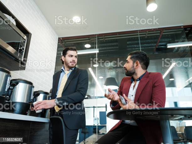 Colleagues talking in the break room picture id1155328037?b=1&k=6&m=1155328037&s=612x612&h=kxna8utmbtaxdic llcpvz4dcx6es8garjupy6hmdta=
