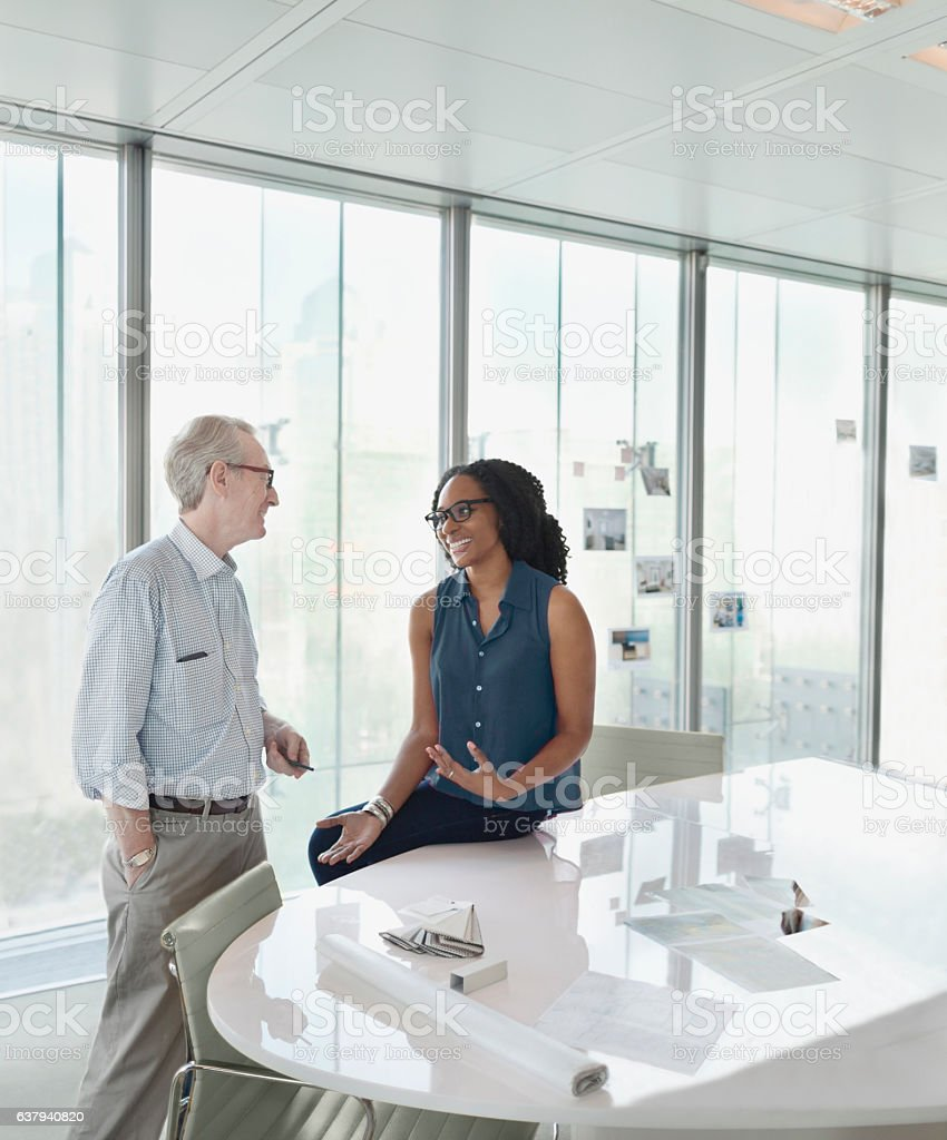 Colleagues talking together in conference meeting room stock photo