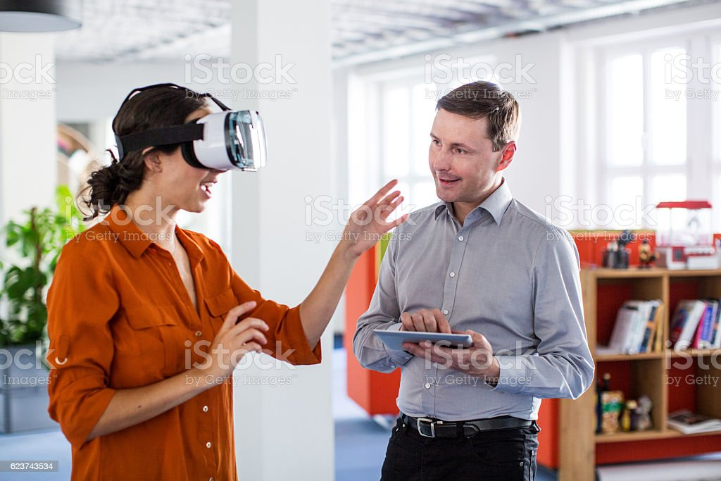 Colleagues testing out virtual reality software stock photo