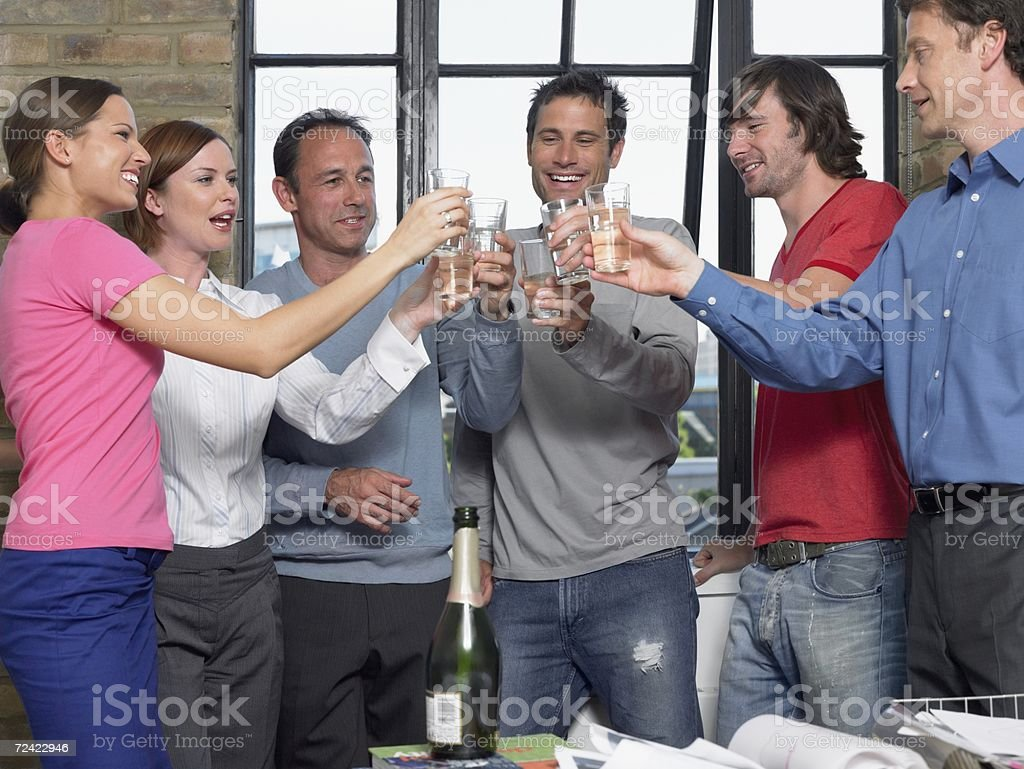 Colleagues toasting success in office royalty-free stock photo