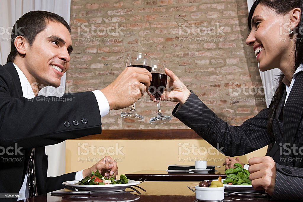 Colleagues toasting with wine 免版稅 stock photo