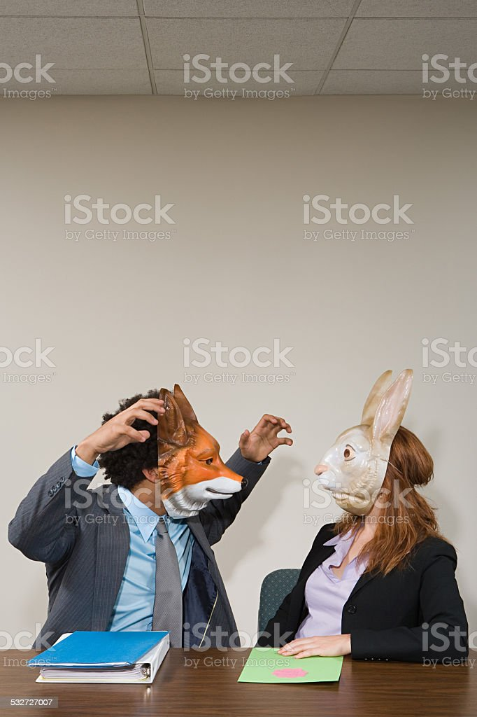 Colleagues wearing masks stock photo