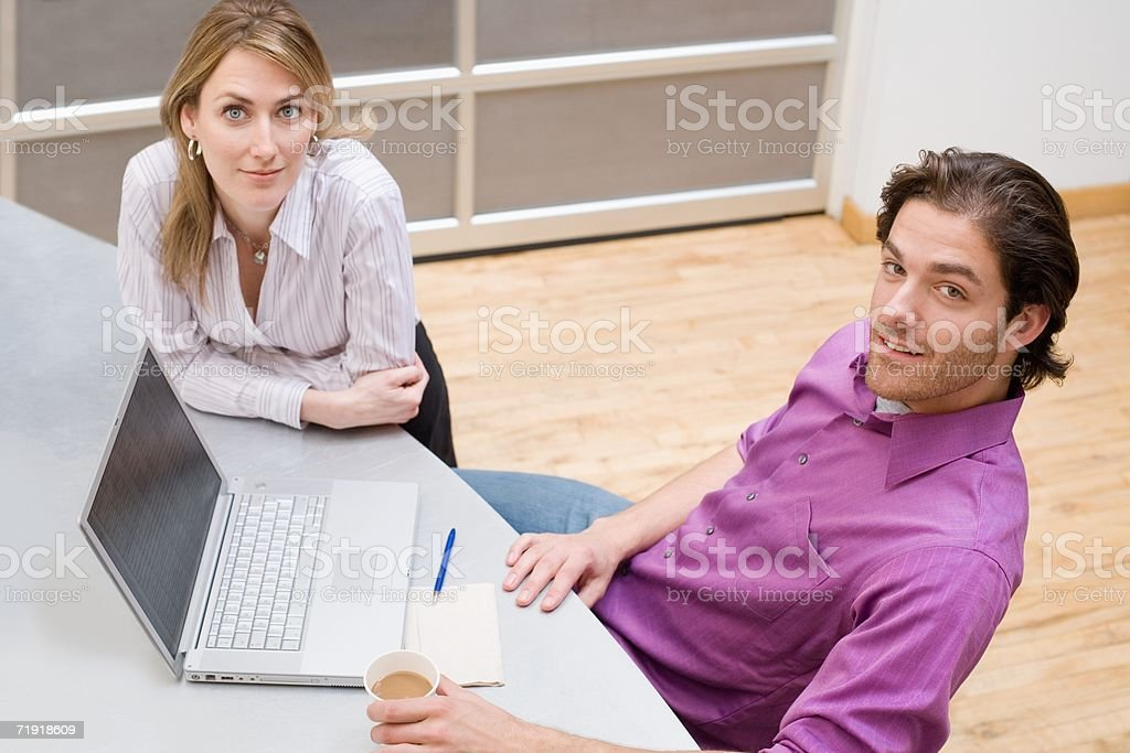 Colleagues with laptop royalty-free stock photo