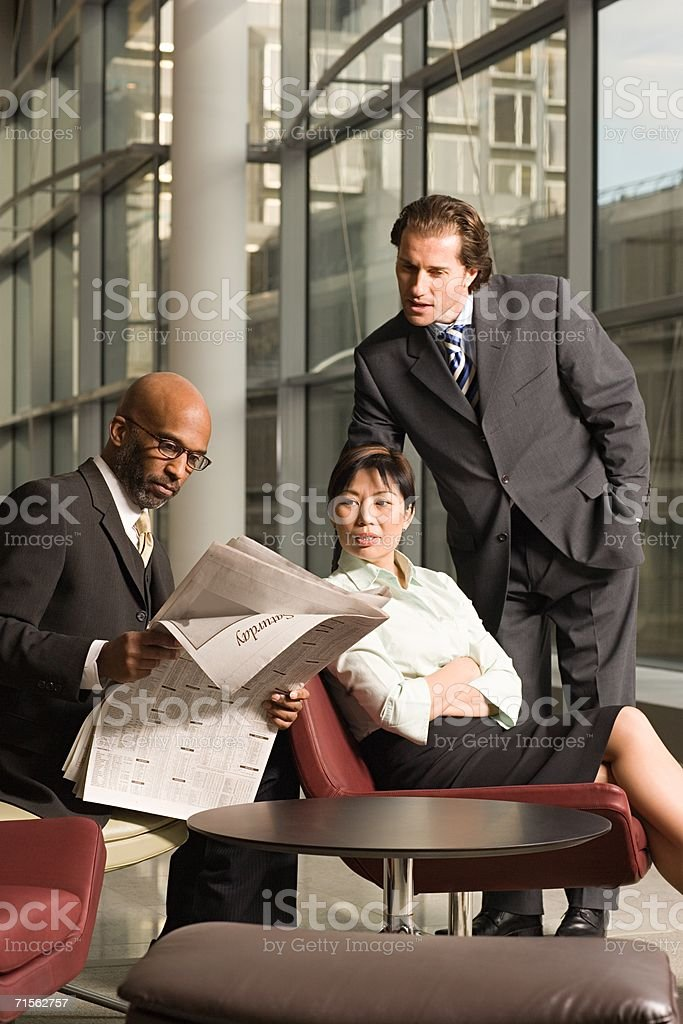 Colleagues with newspaper royalty-free stock photo