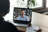 istock Colleagues work distantly using video call and computer 1256907197
