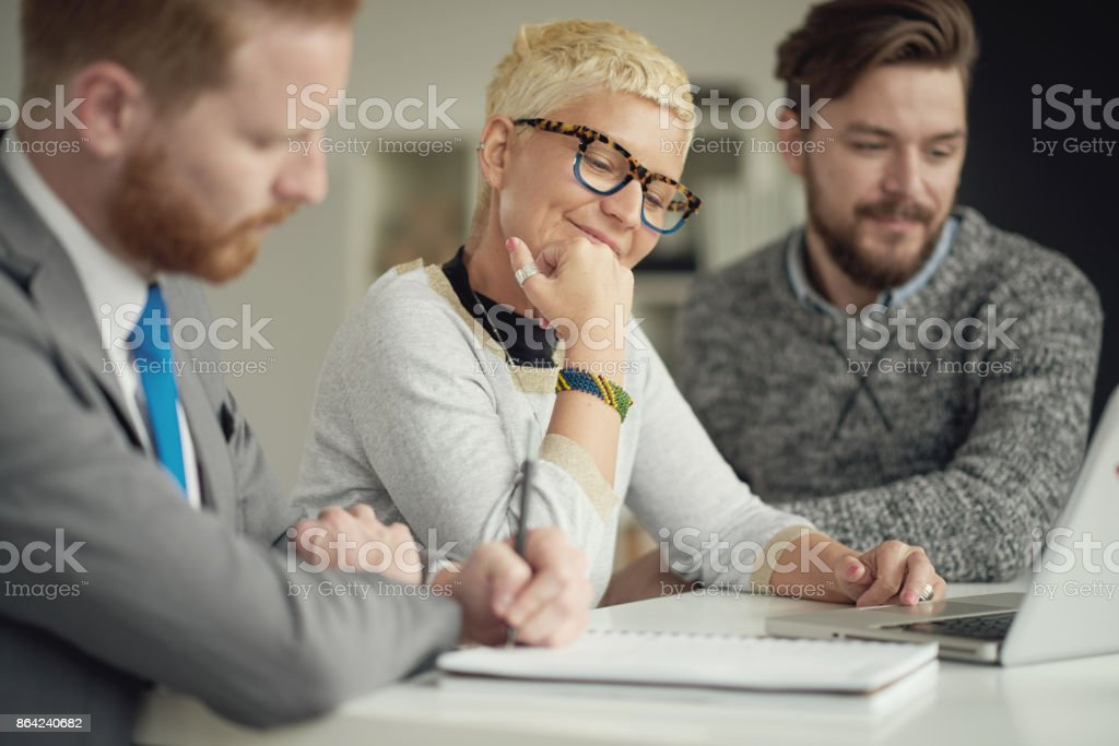 Colleagues working in office royalty-free stock photo