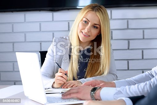 672116416istockphoto Colleagues working together and analyzing financial figures on a laptop 545646482