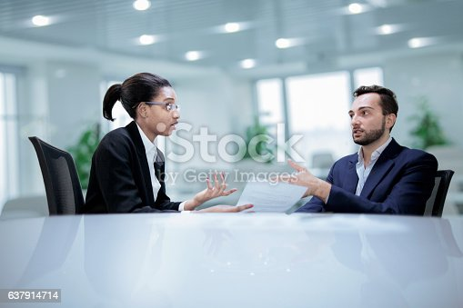 istock Colleagues working together during discussion in office 637914714