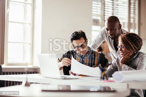 istock Colleagues working together 525043149