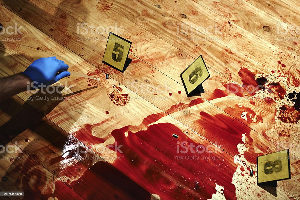 Collecting bloody evidence stock photo