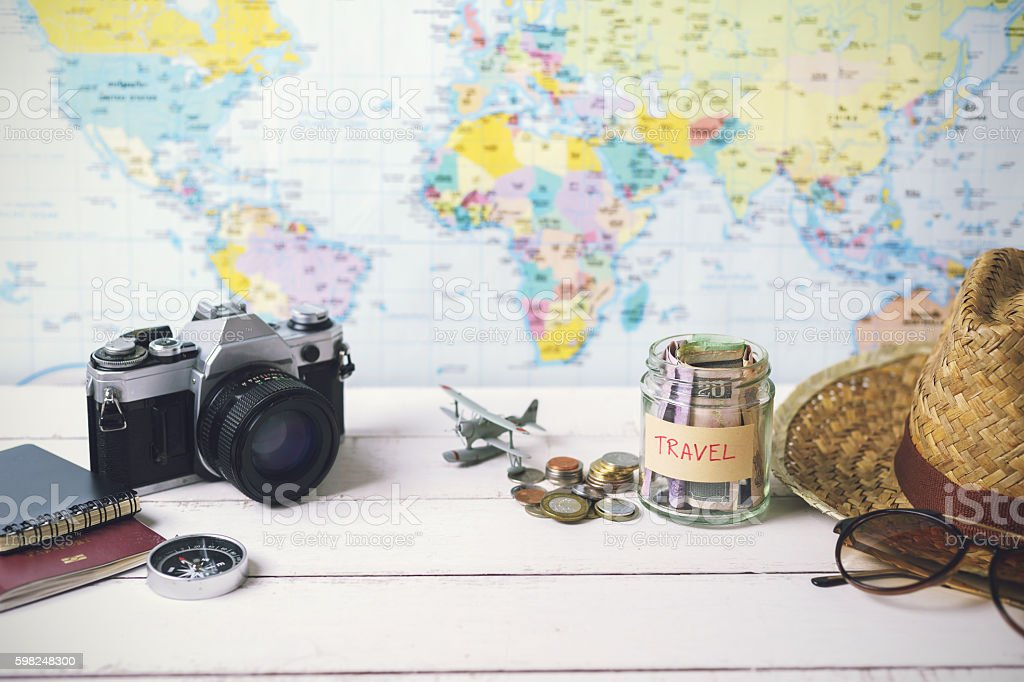 Collecting money for travel with accessories of traveler – Foto