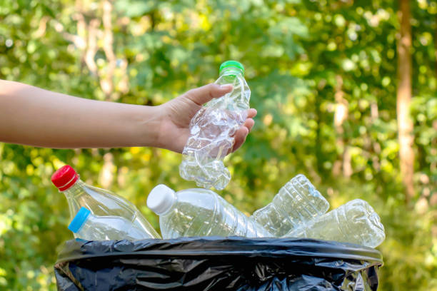 Collecting plastic bottles and glass bottles for reuse. Waste recycling concept. Collecting plastic bottles and glass bottles for reuse. Waste recycling concept. bottle bank stock pictures, royalty-free photos & images