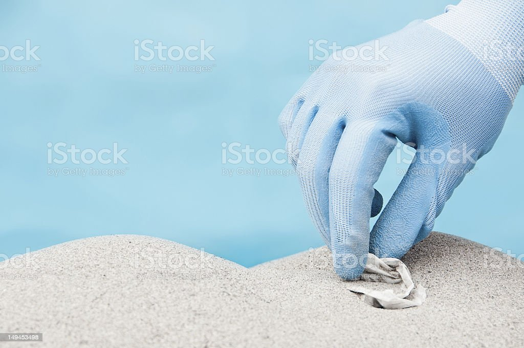 Collecting plastic on a beach stock photo