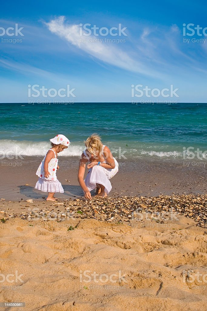 Collecting seashells royalty-free stock photo