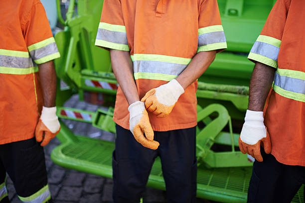 Collecting your trash Cropped shot of a garbage collection team street sweeper stock pictures, royalty-free photos & images