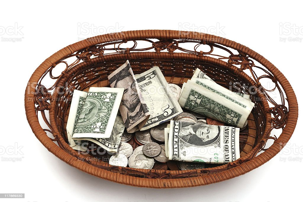 Collection basket filled with money stock photo
