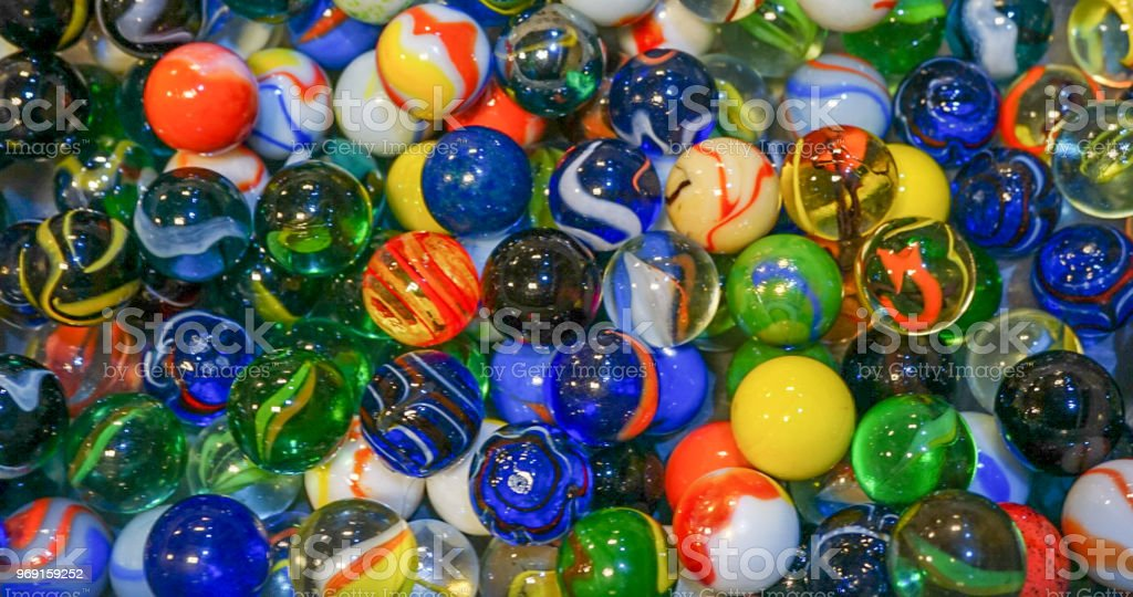 A collection of a variety of colorful marbles stock photo