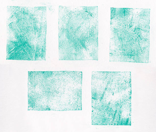 a collection of blue letterpress printed square shapes - stamper stock photos and pictures