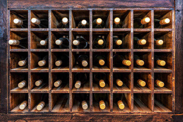 Collection of bottles of wine on wooden cases Collection of bottles of wine on wooden cases wine cellar stock pictures, royalty-free photos & images