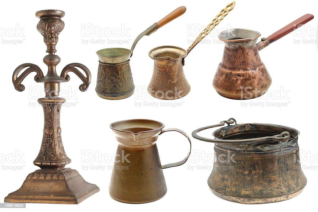 collection of brass objects over white stock photo