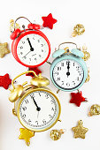 Collection of bright colorful alarm clocks over the white background. New year, christmas, start of new day or party concept