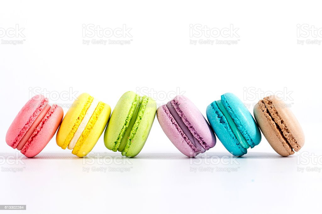 Collection of brightly colored French macarons on white background