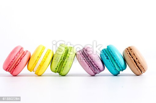 istock Collection of brightly colored French macarons on white background 613302284