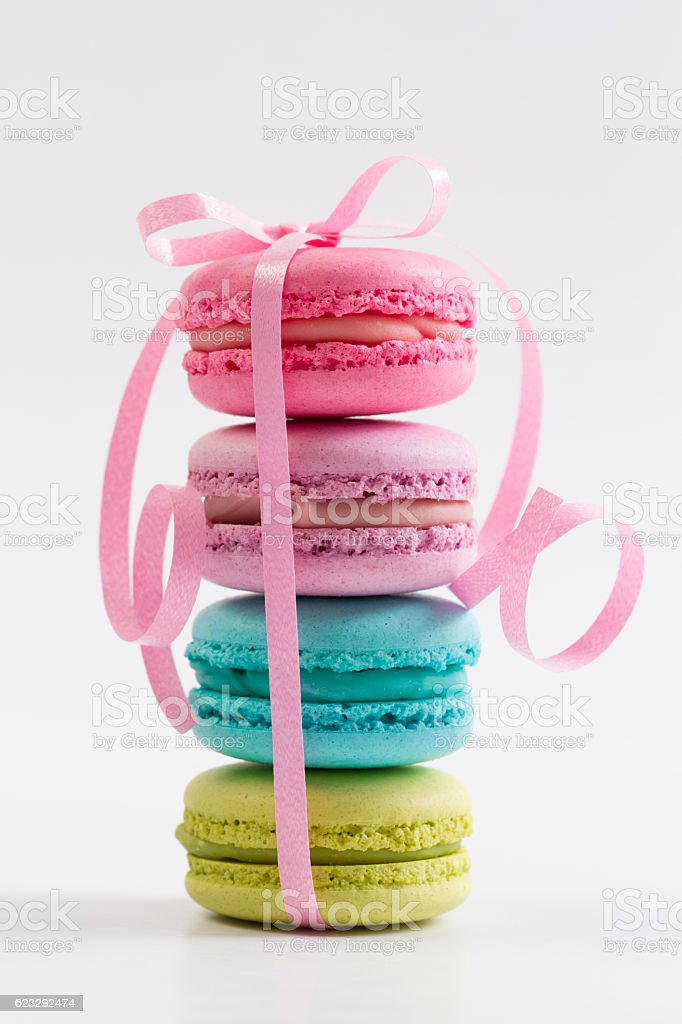 Collection of brightly colored French macaroons on white background stock photo