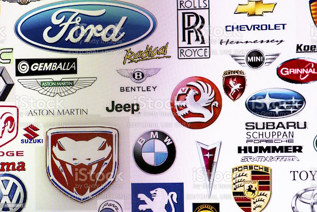 Collection of car manufacturer logos on computer screen stock photo