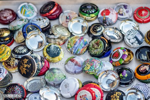 DIEPPE, FRANCE - NOVEMBER 17, 2019: Collection of champagne lids on a flea market for sale