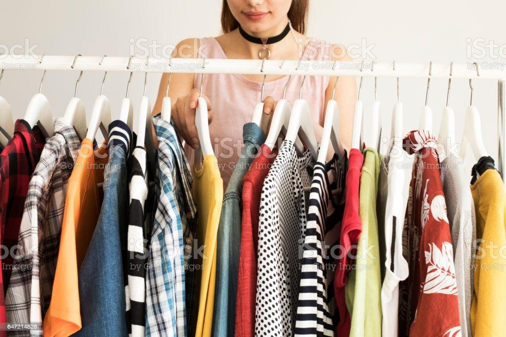 Collection of clothes hanging on rack stock photo