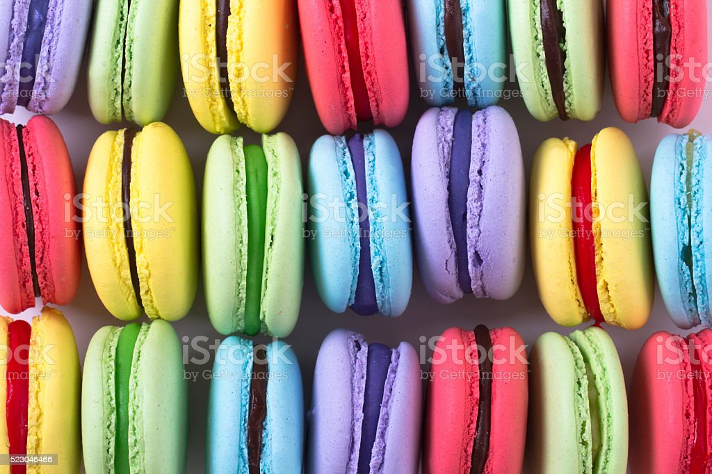 collection of colorful French macarons are next to each other stock photo