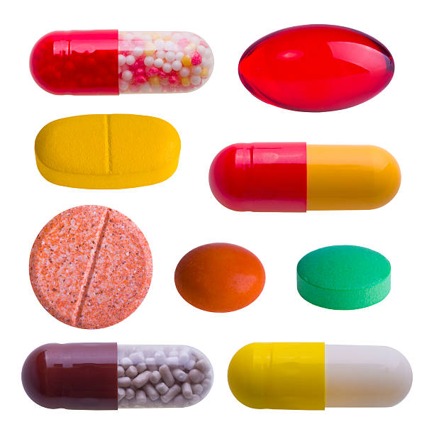 Collection of colorful pills isolated on white stock photo