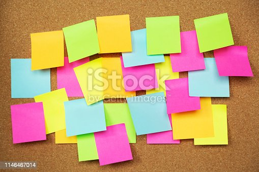 1090161334 istock photo collection of colorful variety. paper note pad reminder sticky notes pin paper yellow on cork bulletin board. empty space for text. 1146467014