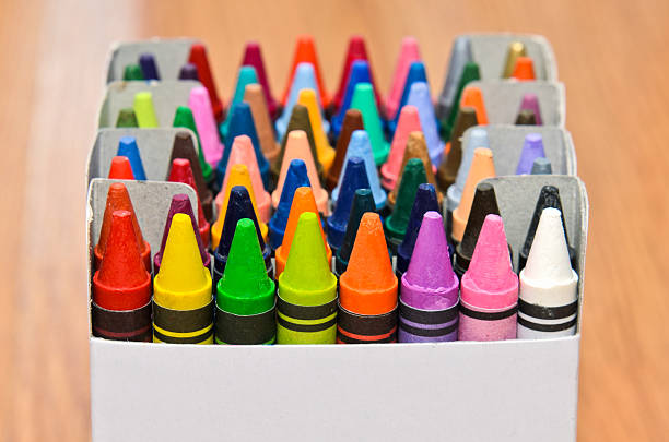 Collection of colorful wax crayons  in boxes stock photo