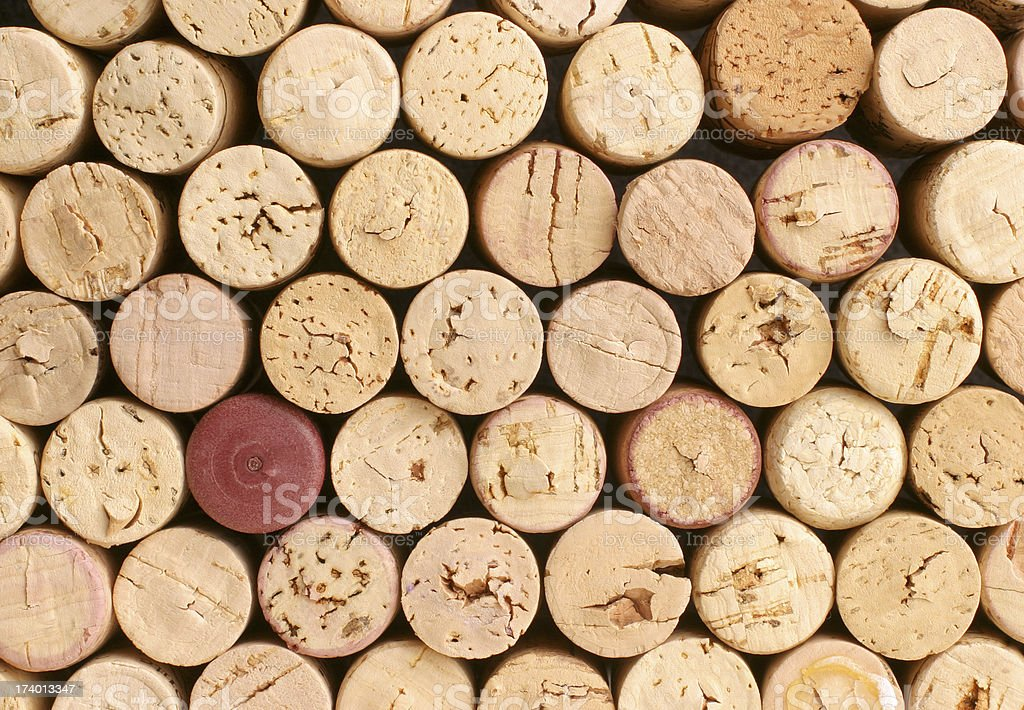 Collection of corks with one red one that doesn't match stock photo