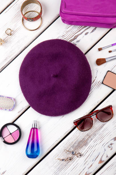 Collection of cosmetic accessories. Collection of cosmetic accessories. Purple violet beret hat, spectacles and perfume. beret stock pictures, royalty-free photos & images