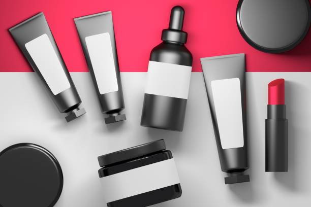 Collection of cosmetic packaging bottles with lipstick stock photo
