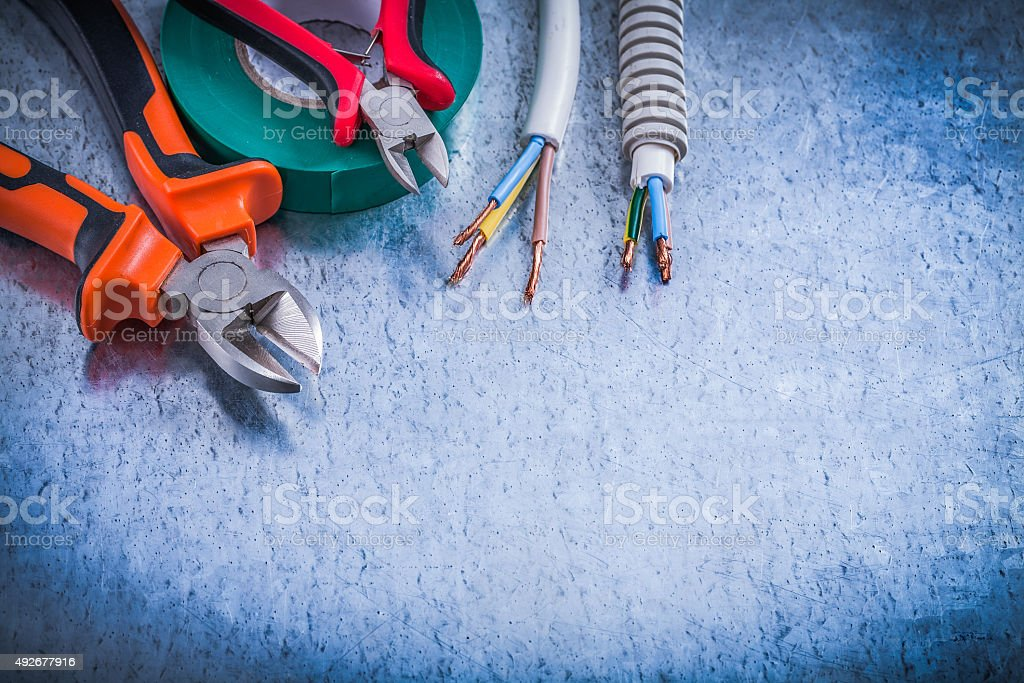 Collection of cutting pliers corrugated pipe wire protection ins stock photo