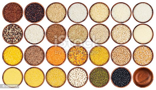 istock Collection of different groats isolated on white background. Top view of peas, cereals, rice, legumes, beans and lentils in wooden bowls. 876666890